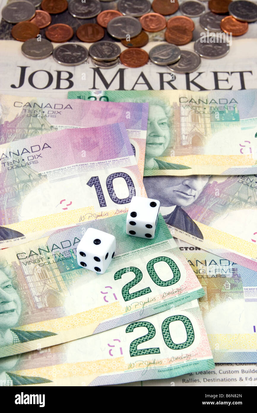 Dollar bills, coins, and dice laying on newspaper with the words 'Job Market' visible, symbolizing today's - Stock Image