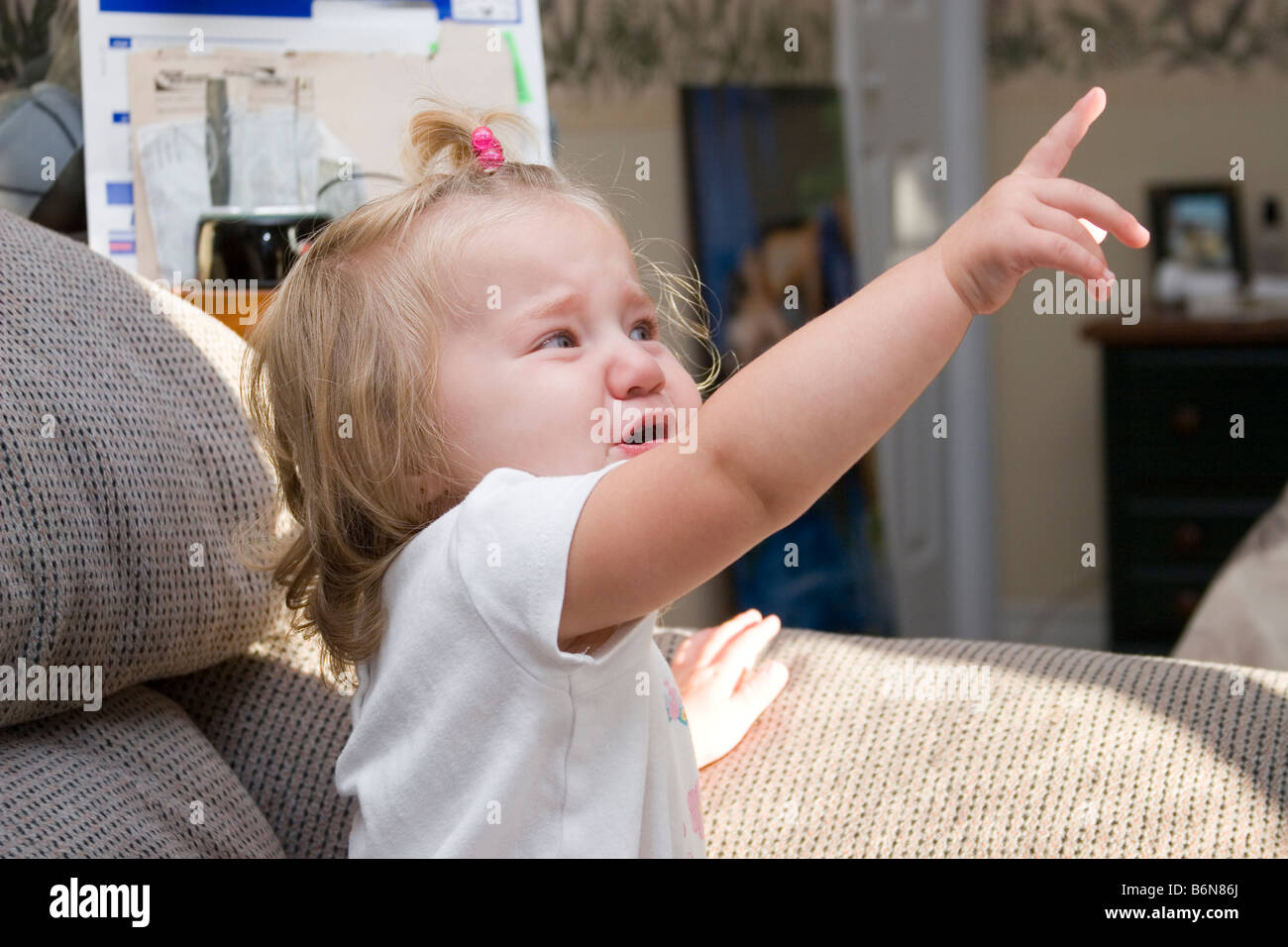 1 to 2 year old toddler girl upset and crying having tantrum - Stock Image