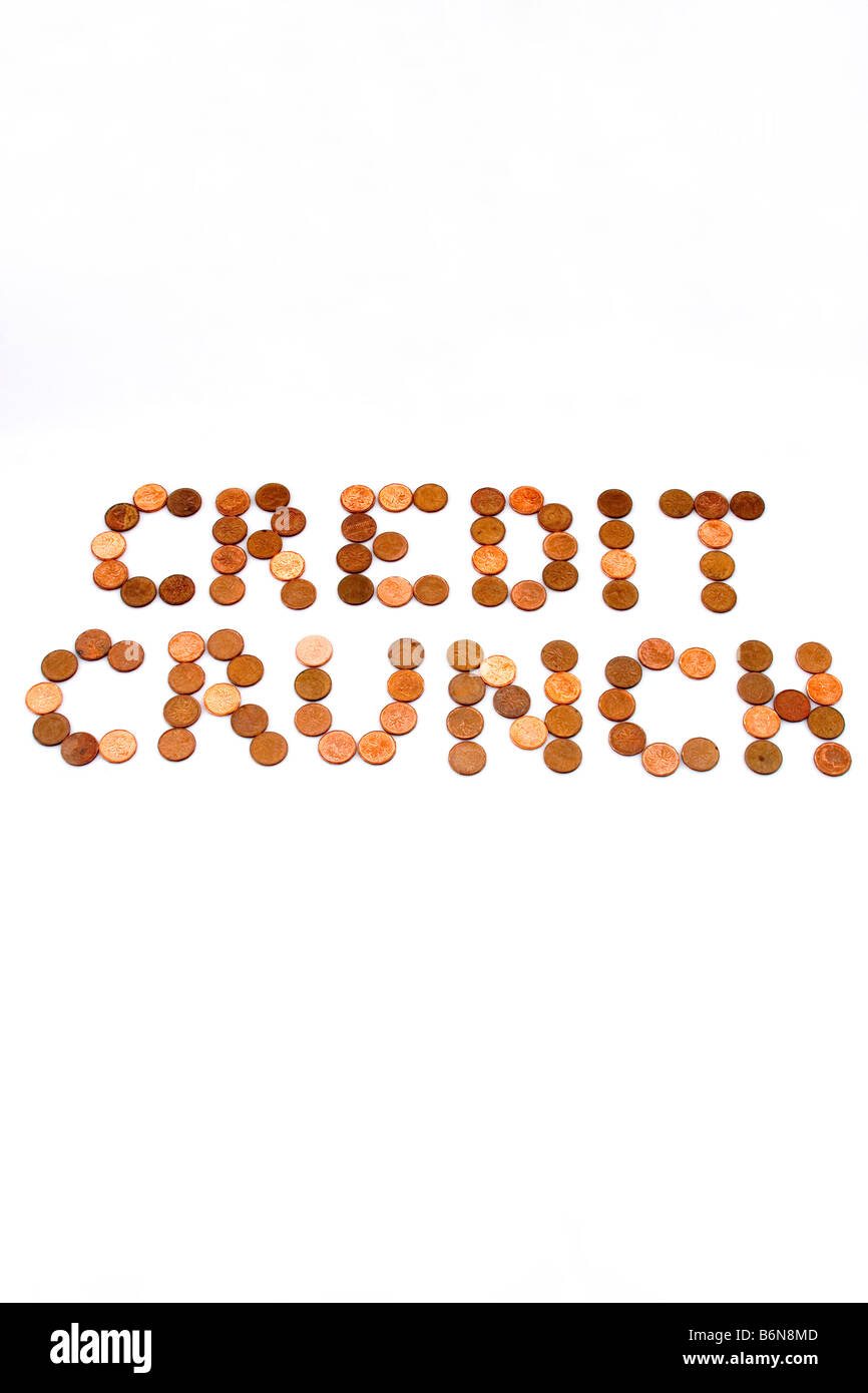 Concept of words 'Credit Crunch' spelled out in pennies on white background symbolizing lean times - Stock Image