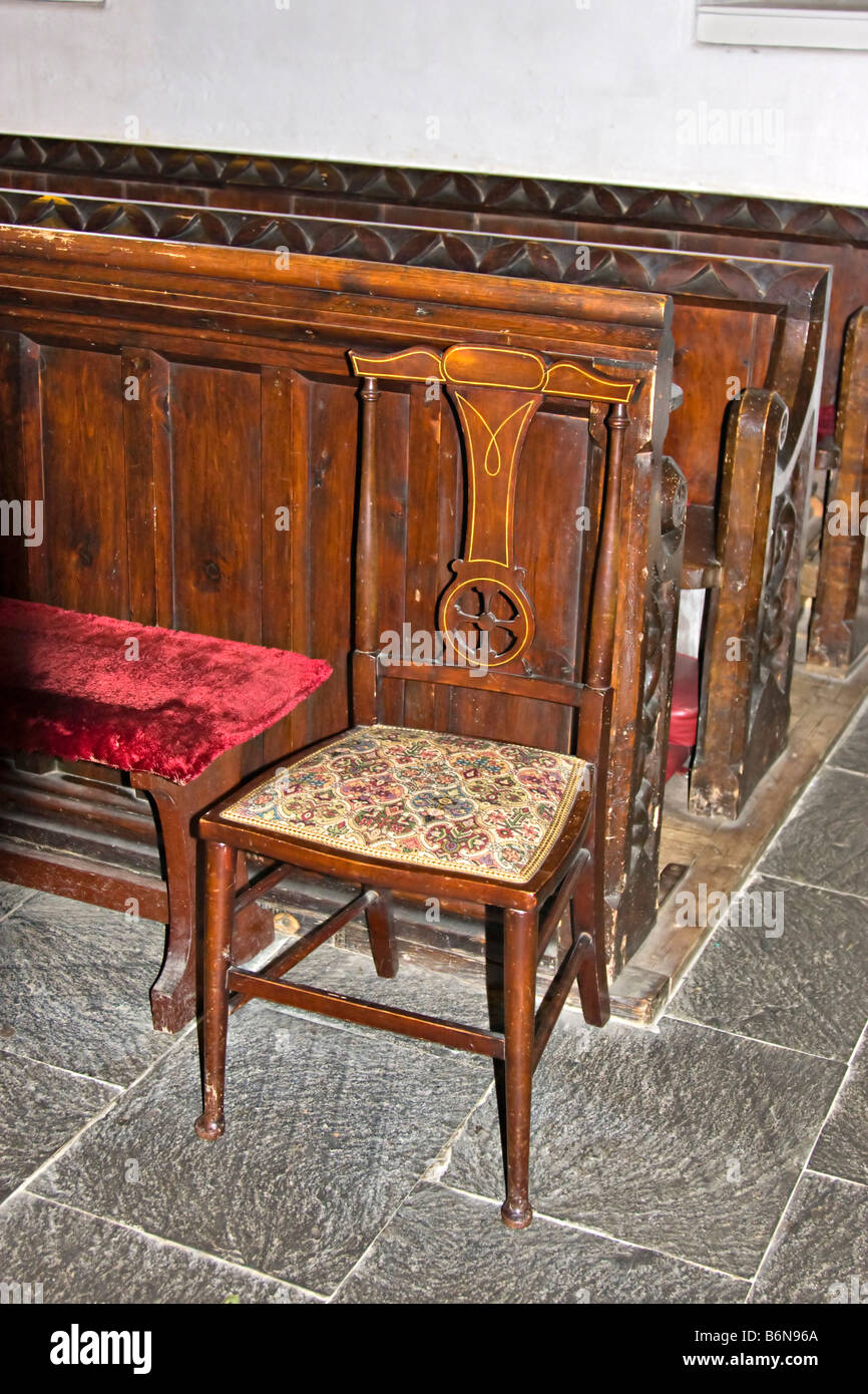 Chair with needlepoint seat cushion in the 13th century Church of St Just in Roseland, Carrick, Cornwall - Stock Image