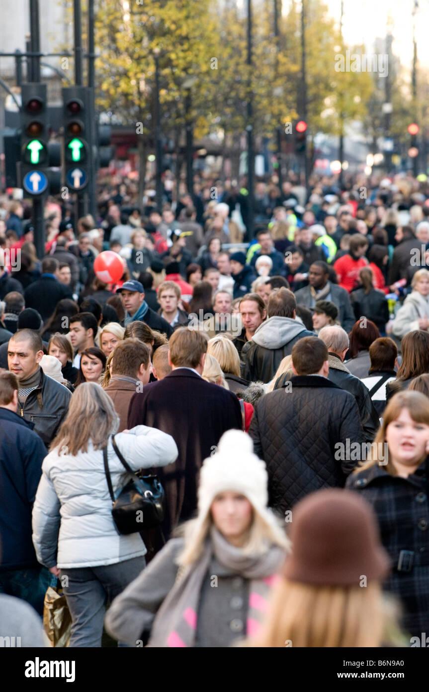 Shoppers on Oxford Street, London, England, UK - Stock Image