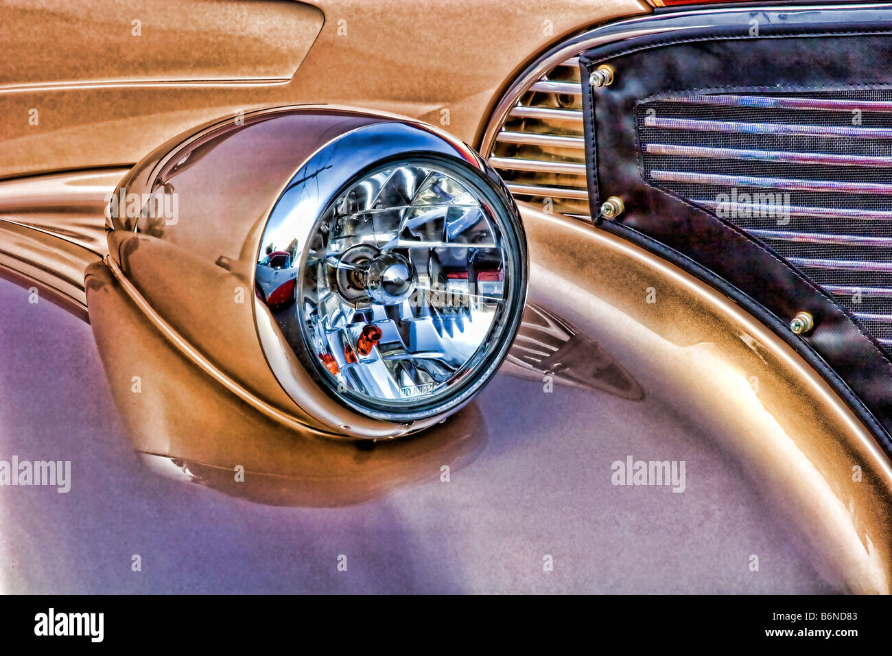 Photo illustration painterly effect of antique car. - Stock Image