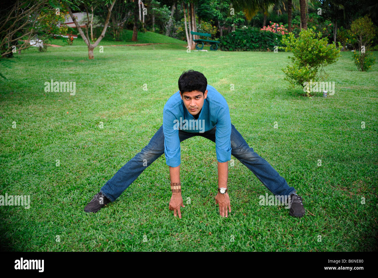 An indian boy doing excercise - Stock Image