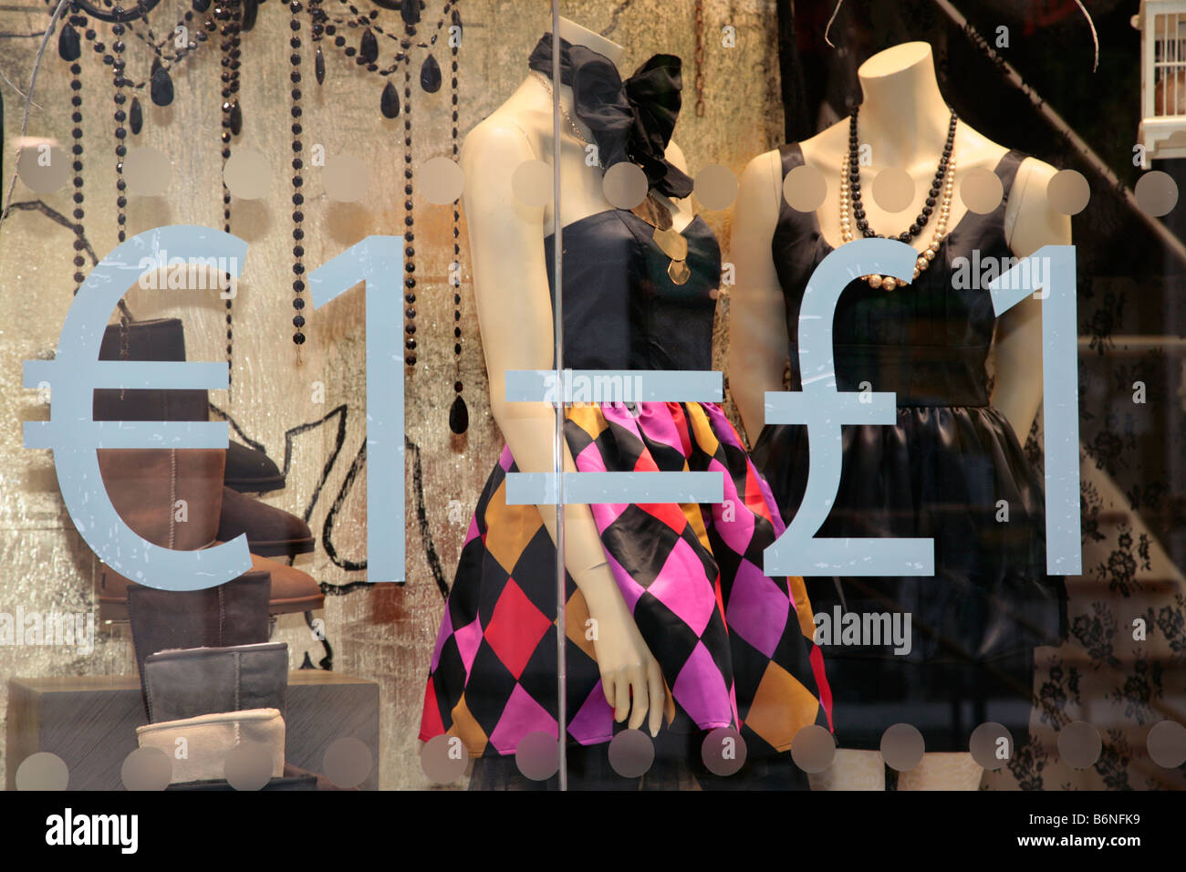 one euro equals one pound sign in the window of a fashion shop in belfast city centre uk Stock Photo
