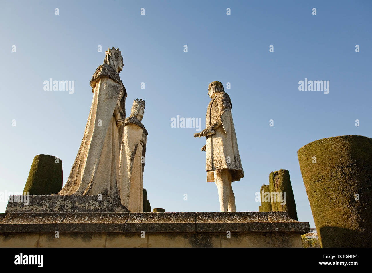 statues of Columbus and the Catholic Monarchs alcazar of the reyes cristianos cordoba andalusia spain - Stock Image