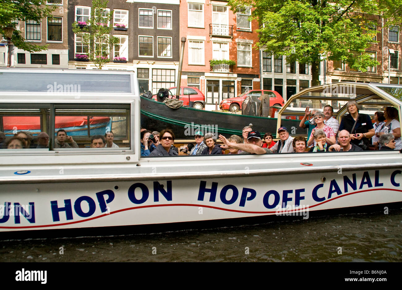 Amsterdam canal sightseeing cruise on Hop On Hop Off Cruises boat - Stock Image