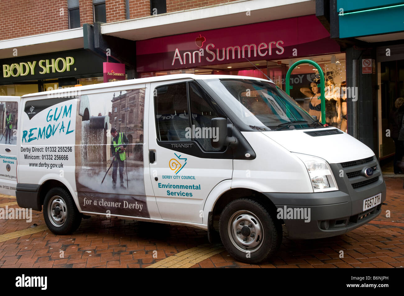 Gum Removal contractors & van outside Ann Summers. Derby, Derbyshire, UK - Stock Image