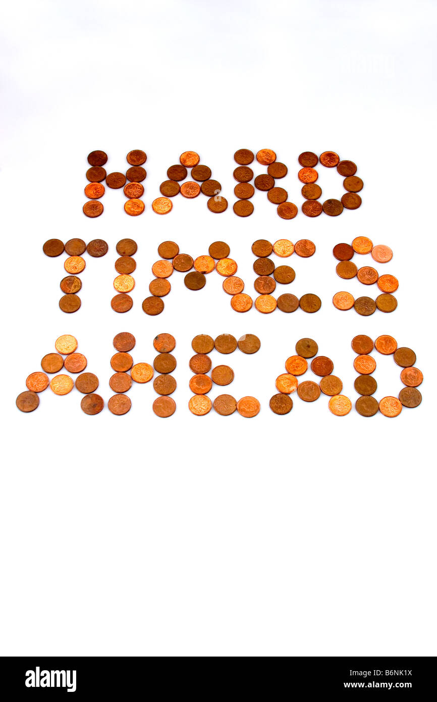 Concept of words 'Hard Times Ahead' spelled out in pennies on white background symbolizing lean times - Stock Image