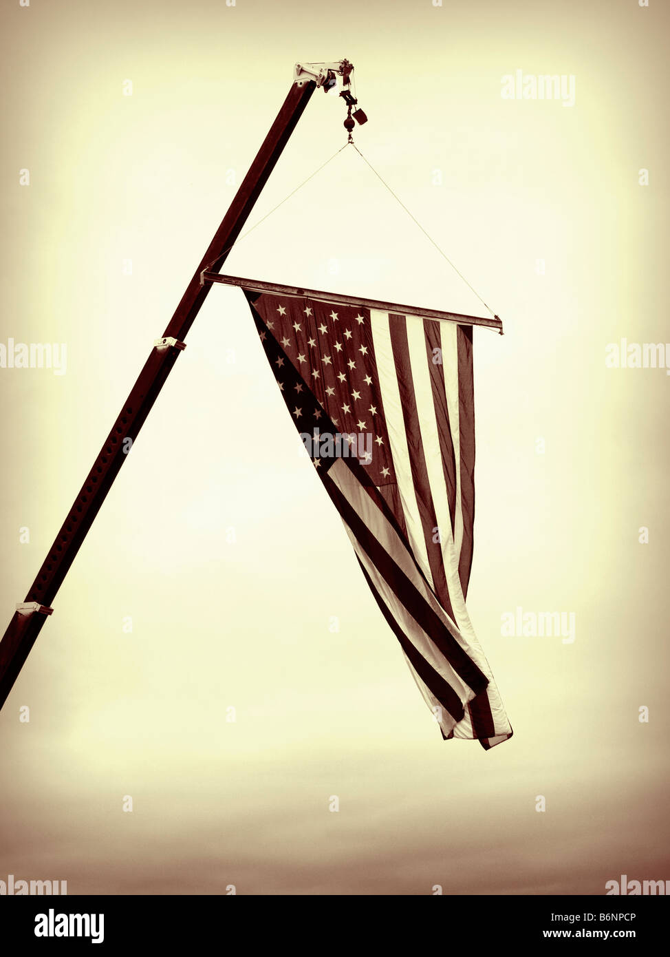 A close up on the American flag suspended from a crane Stock Photo
