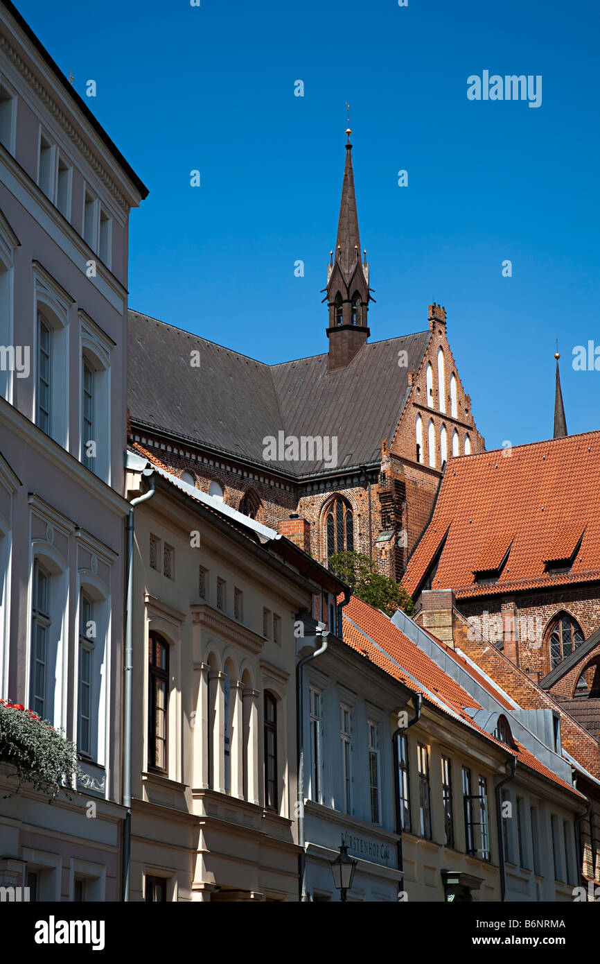 Church tower and house roofs Wismar Germany - Stock Image
