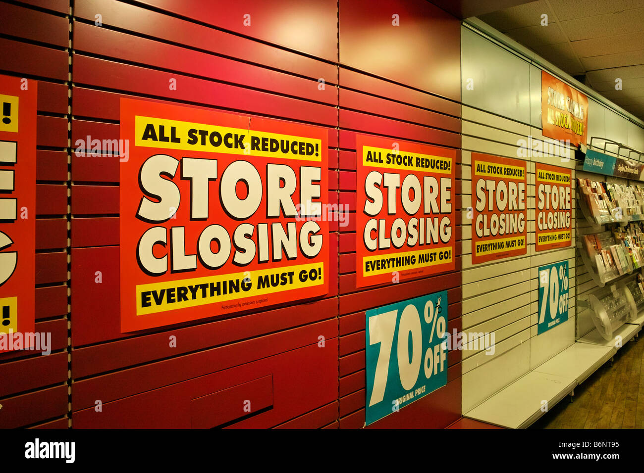 inside a woolworths store during the closing down process - Stock Image