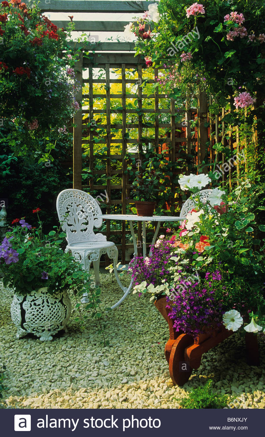 Private Garden Wolverhampton Secluded Patio Area Wih Table And Chairs  Containes And Hanging Baskets Trellis Divider