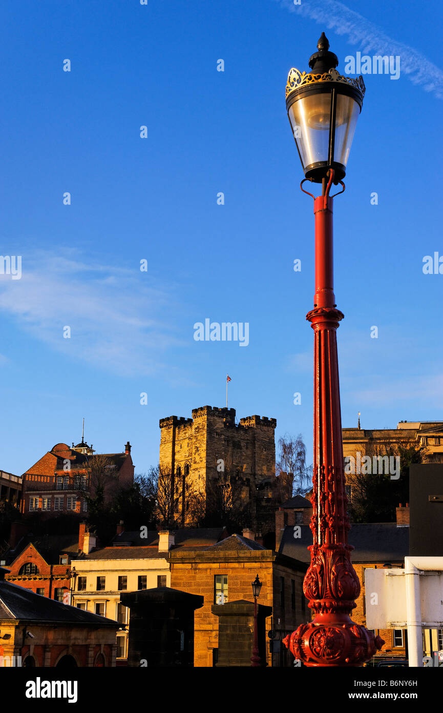 Ornate lampost against blue sky on Newcastle-upon-Tyne  Swingbridge with the Newcastle castle keep in background - Stock Image