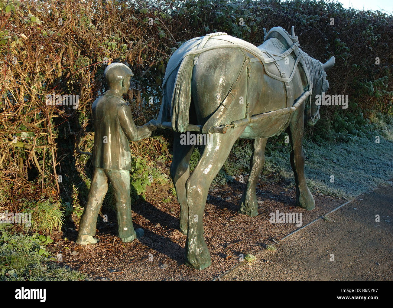 sculpture of boy and pony on the towpath of the Grand Union Canal, Foxton, Leicestershire, England, UK - Stock Image