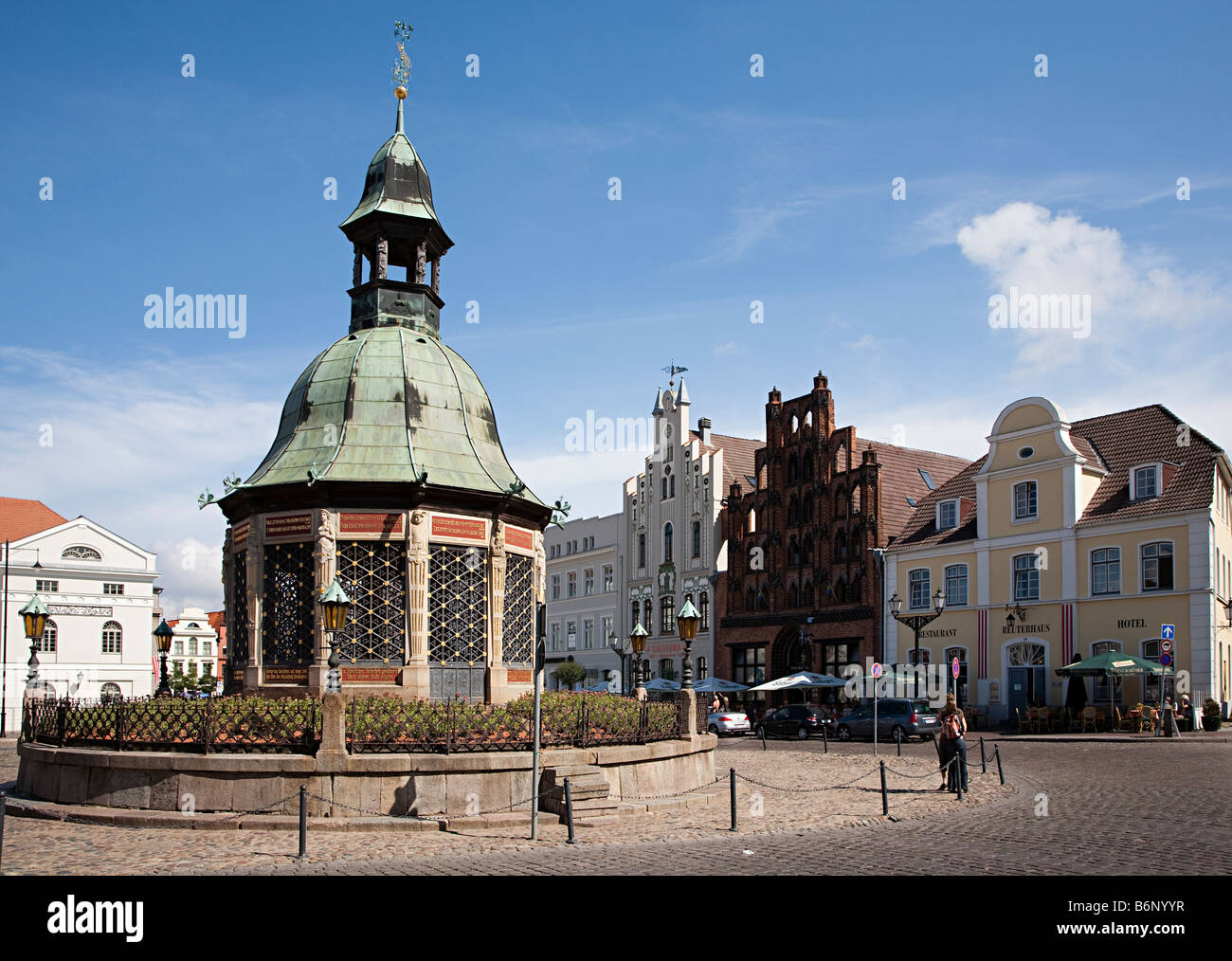 Wasserkunst waterworks 12 sided well to supply drinking water from a well in the market place Wismar Germany - Stock Image