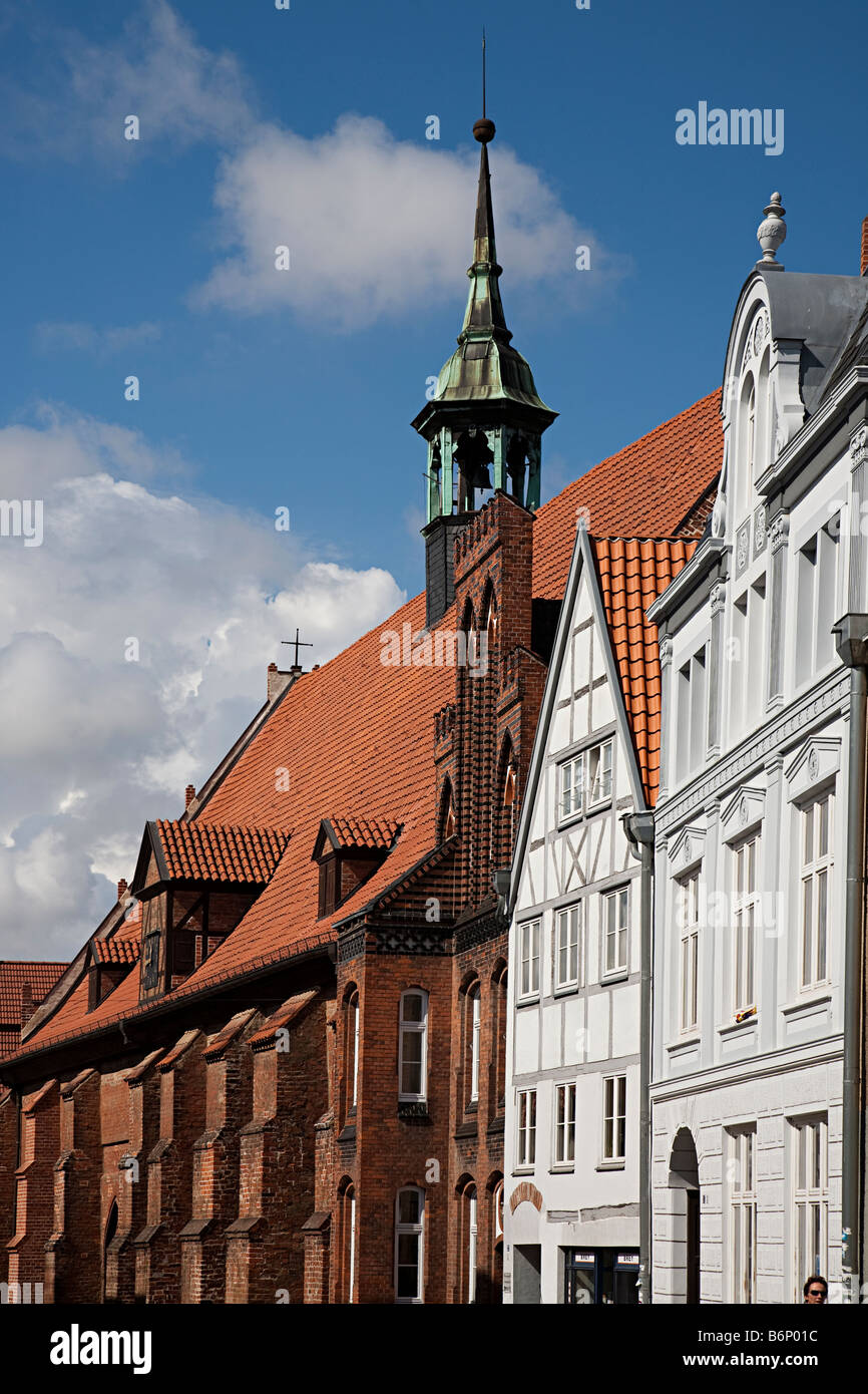 Belltower and red brick architecture in street Wismar Germany - Stock Image