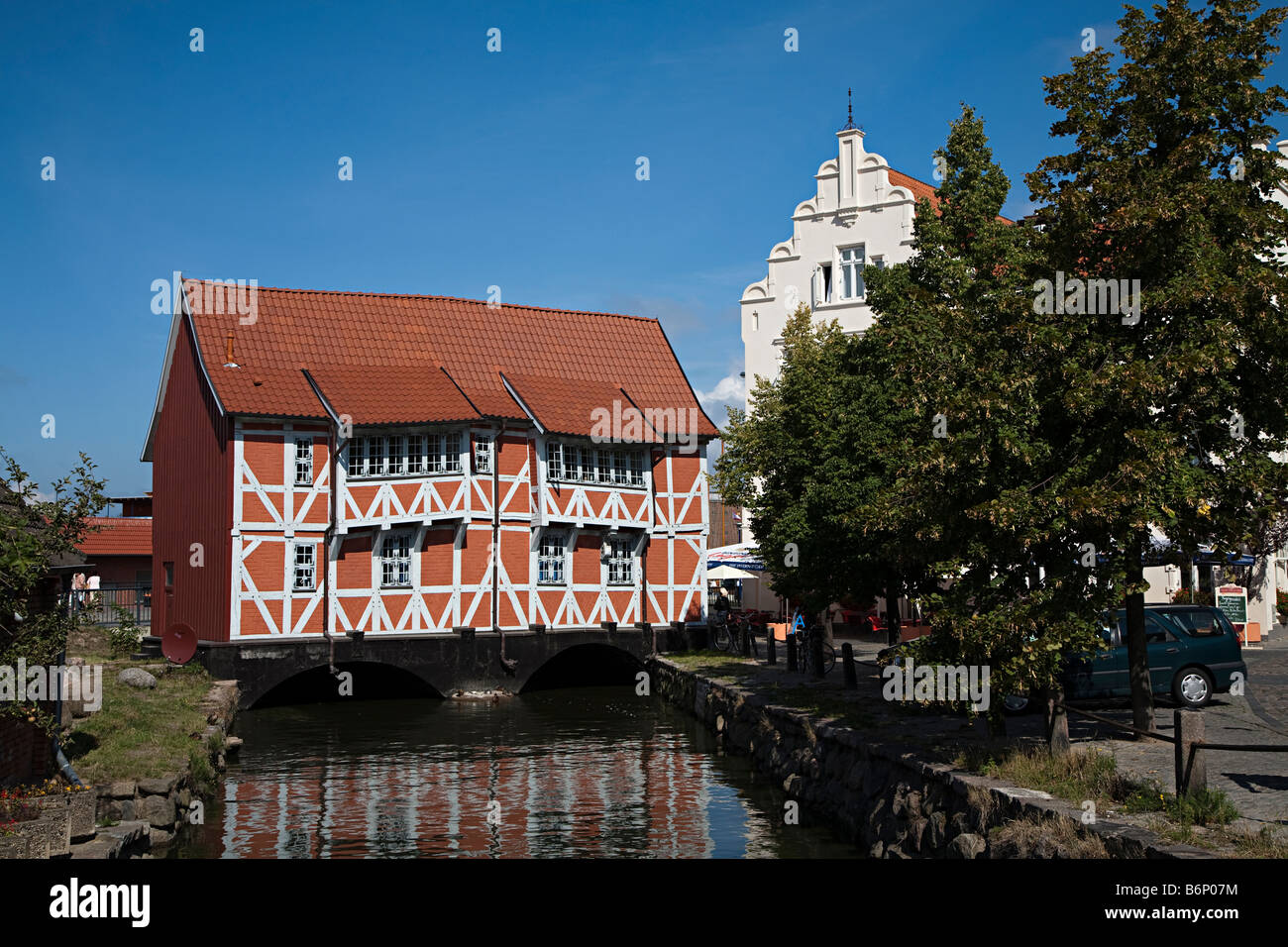 Old style timbered building spanning canal Wismar Germany Stock Photo