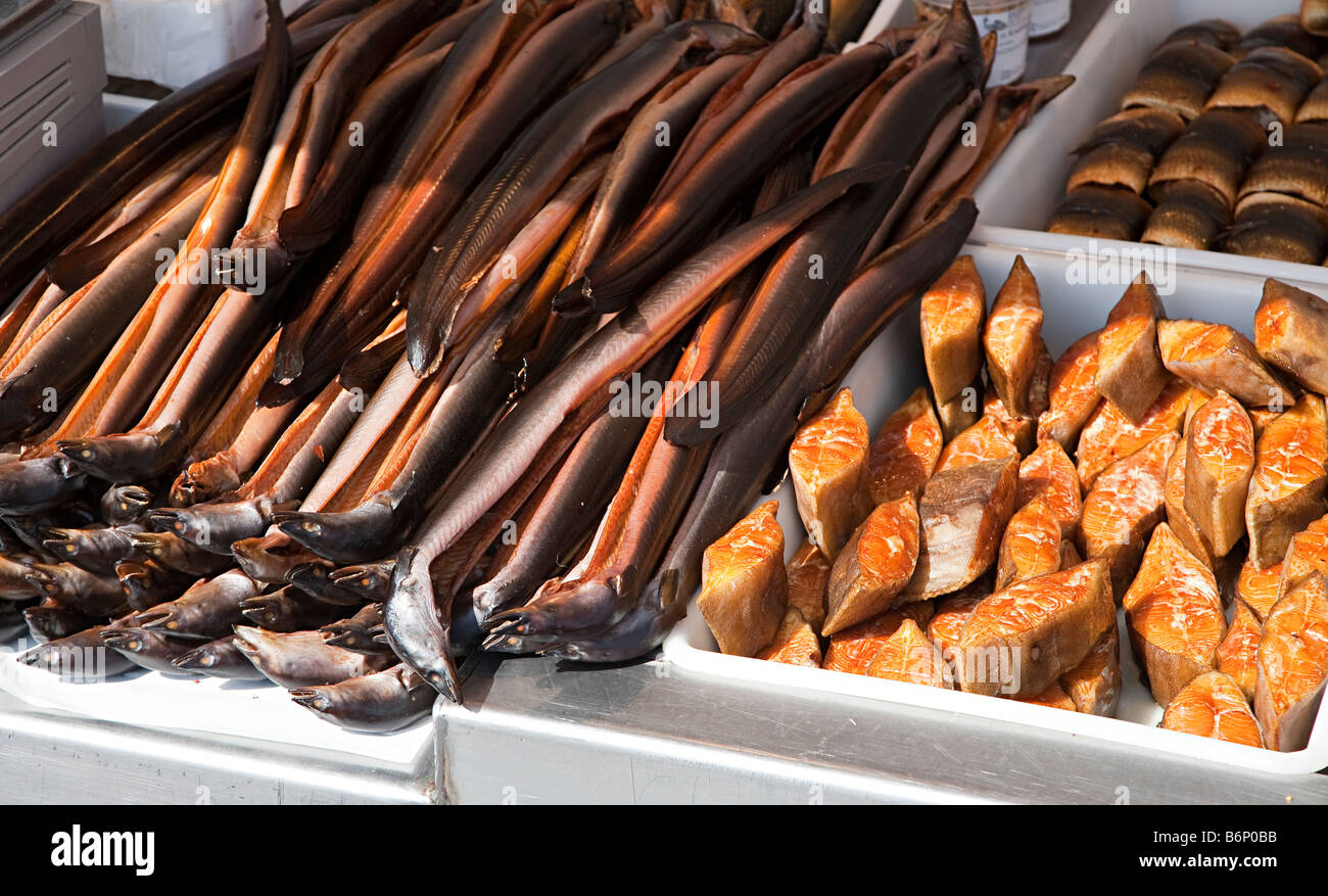 Local delicacy smoked eel and fish on sale at harbour Wismar Germany - Stock Image