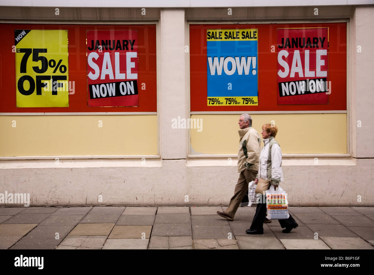 Signs announce the start of the January sales on a British high street. - Stock Image