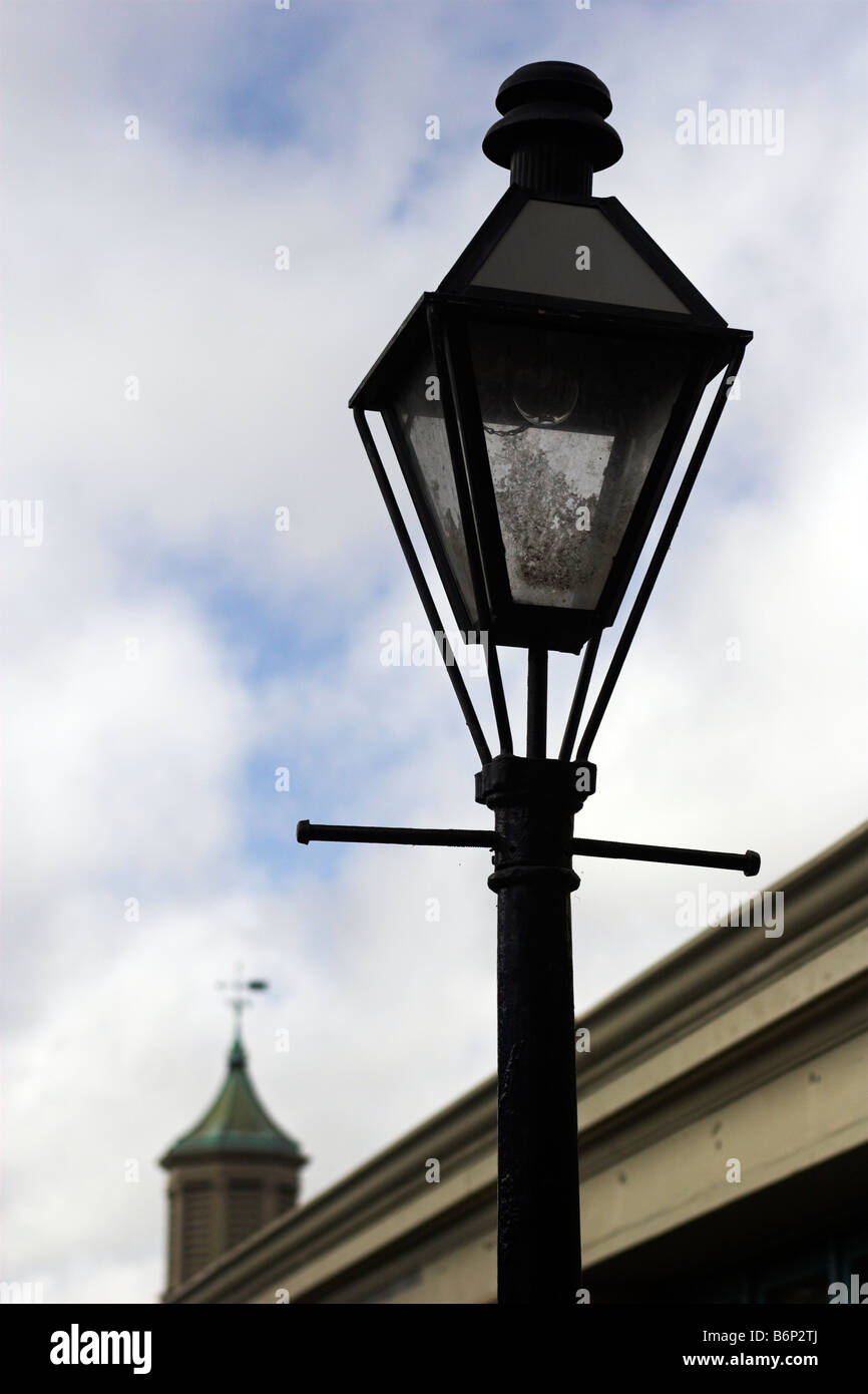 A traditional lamp post on Decatur in the New Orleans French Quarter. - Stock Image
