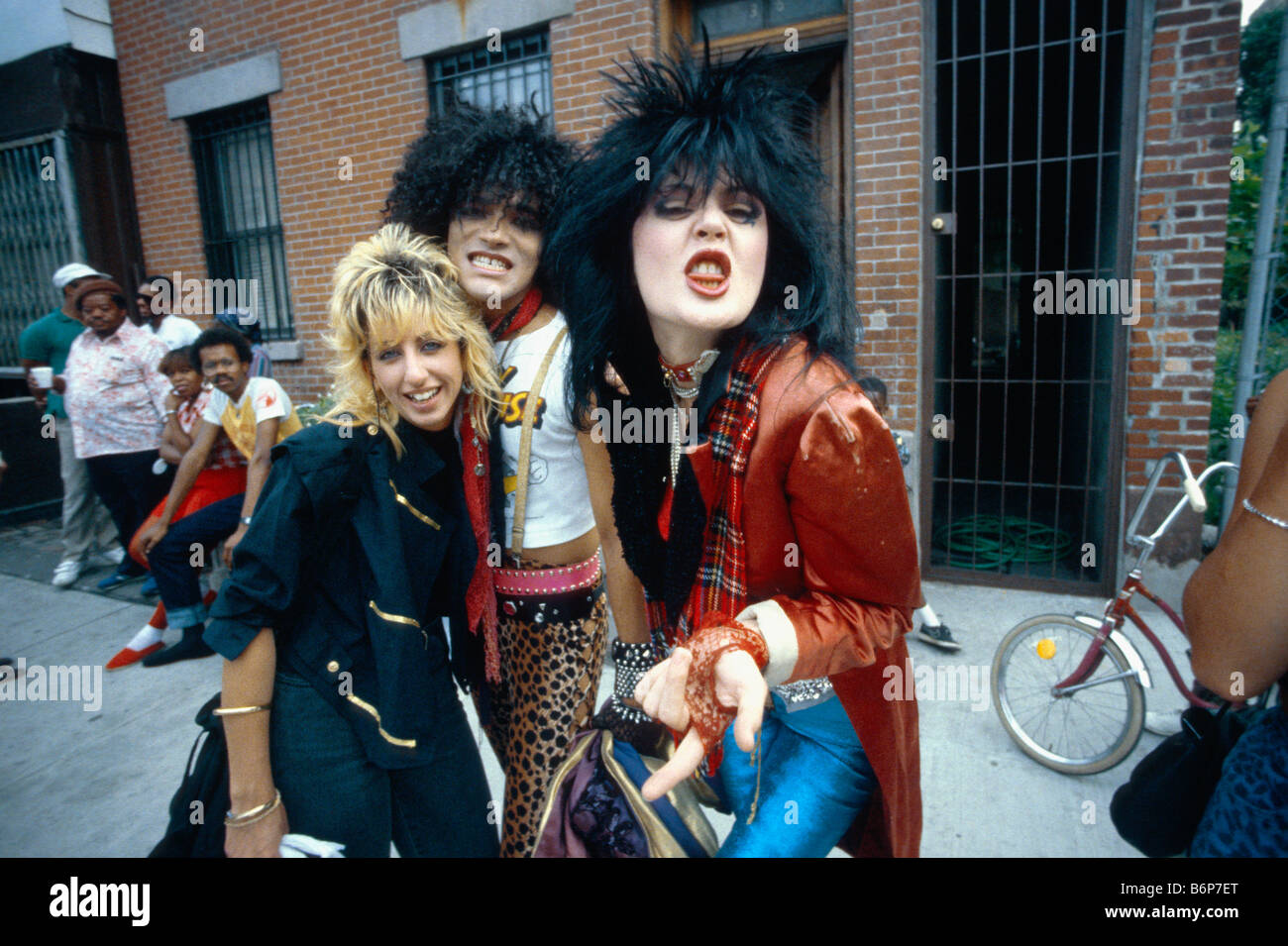 young fancy dressed punk people in Lower Eastside of Manhattan, New York, pull funny faces - Stock Image