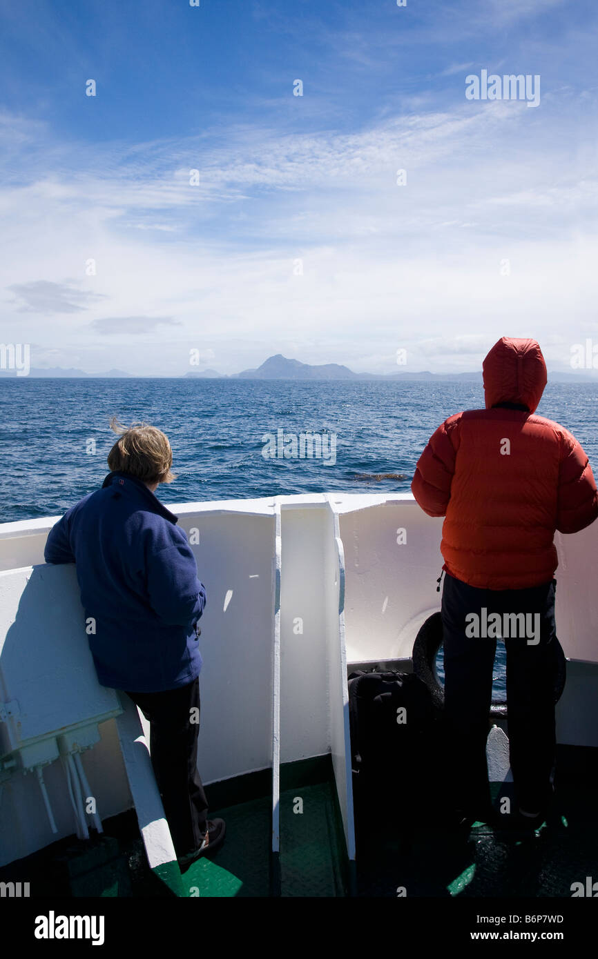 Tourists watch approach Cape Horn island southernmost headland of Tierra del Fuego archipelago of southern Chile - Stock Image