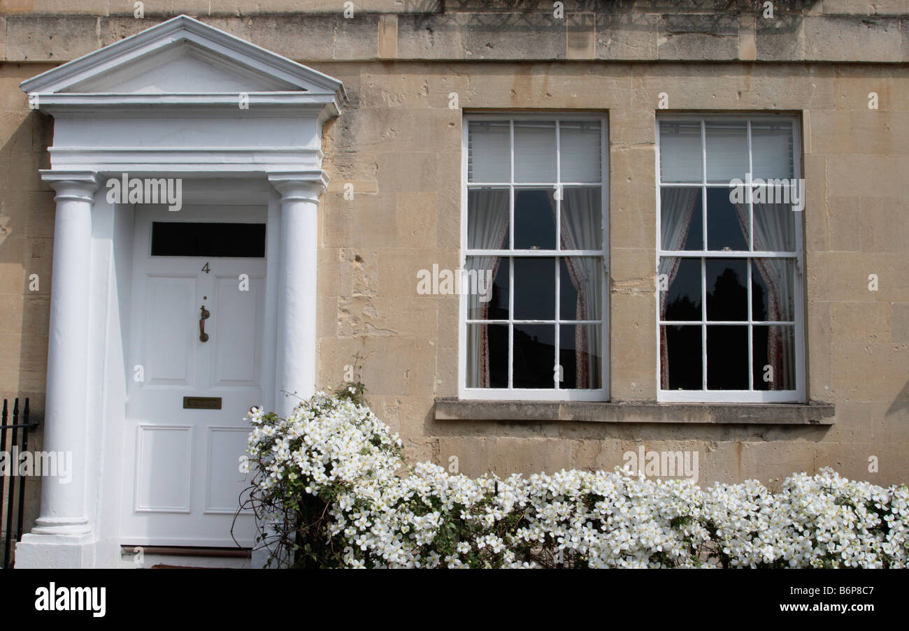 Bath Somerset UK Architectural detail of Georgian town house front door with pedimented porch, sash windows and - Stock Image