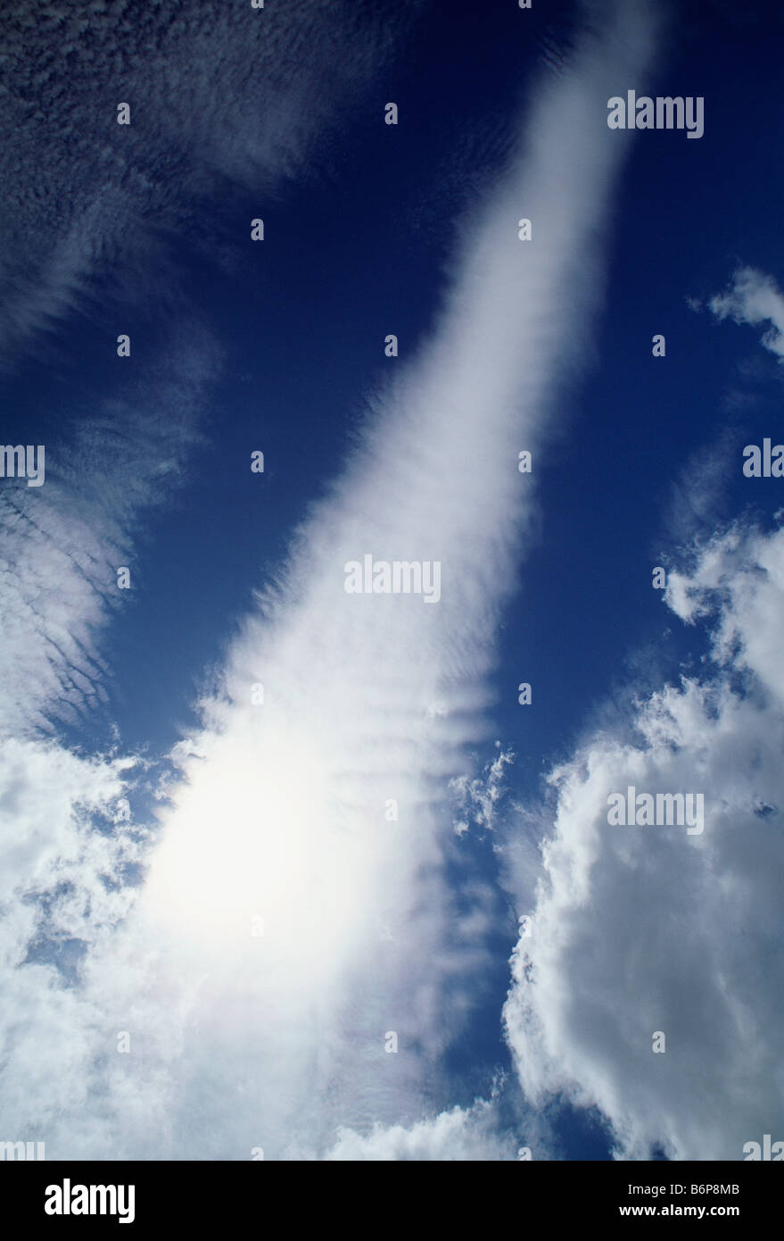 Dramatic white clouds against a blue sky - Stock Image