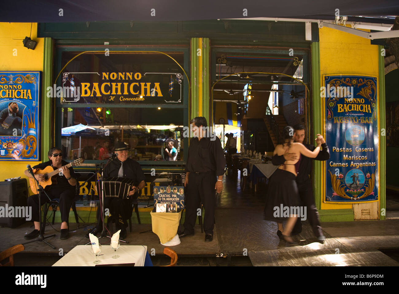 Tango dancers and band in street cafe in La Boca Buenos Aires Argentina South America - Stock Image