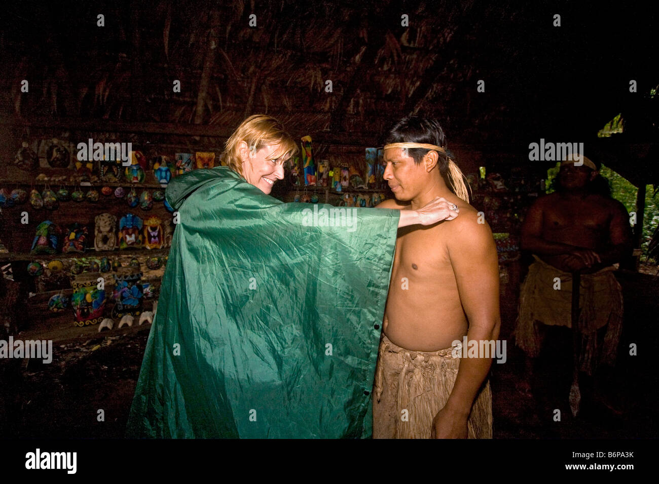 Visitors exchange traditional greeting with maleku indian member of visitors exchange traditional greeting with maleku indian member of inca tribe in a rainforest near arenal volcano in costa rica m4hsunfo