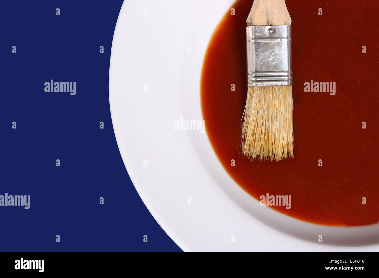 A White Bowl of Bar-B-Que Sauce on a Blue Background - Stock Image