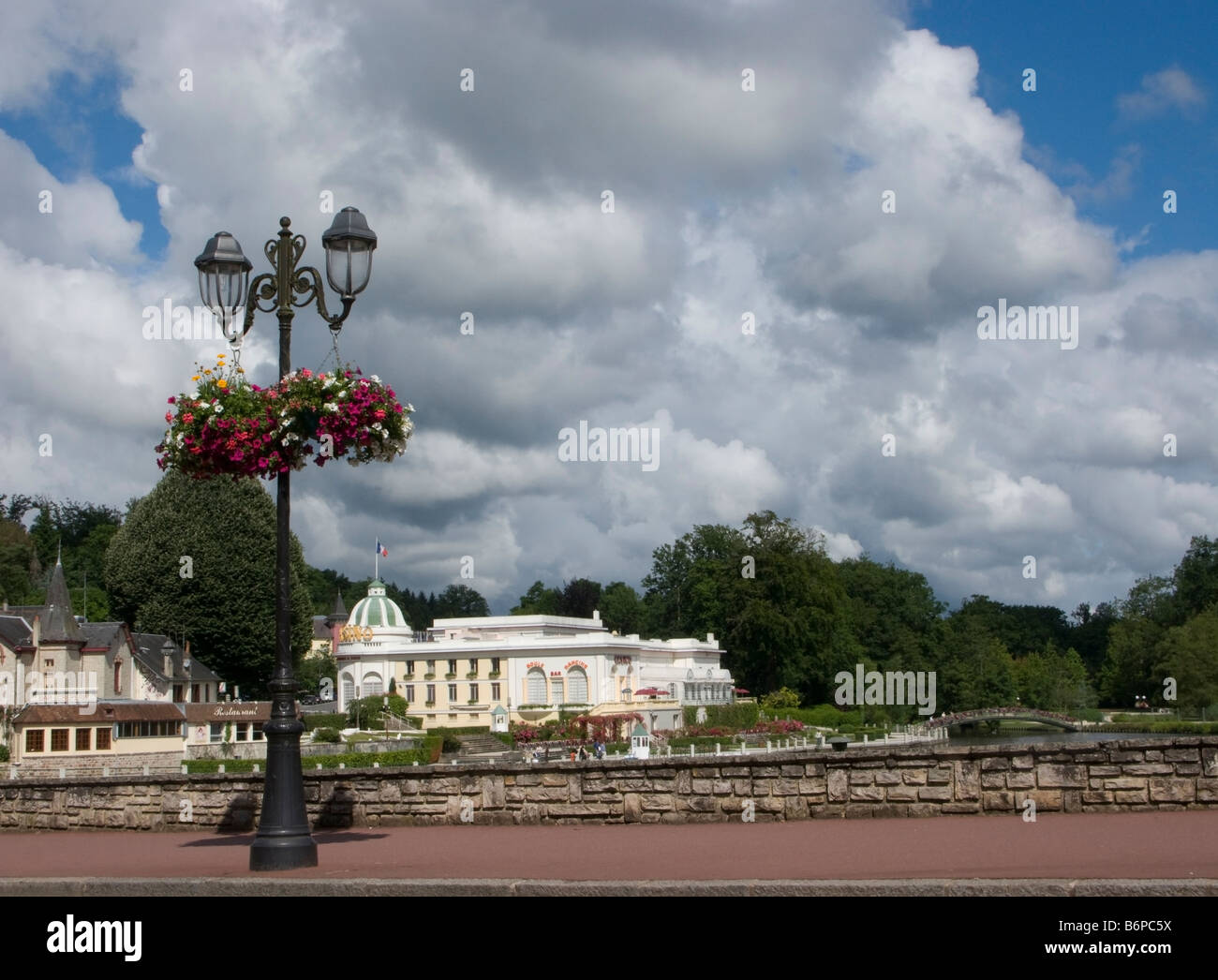 Park lake and casino at Bagnoles de l Orne which is in the Orne 61 departement of France - Stock Image