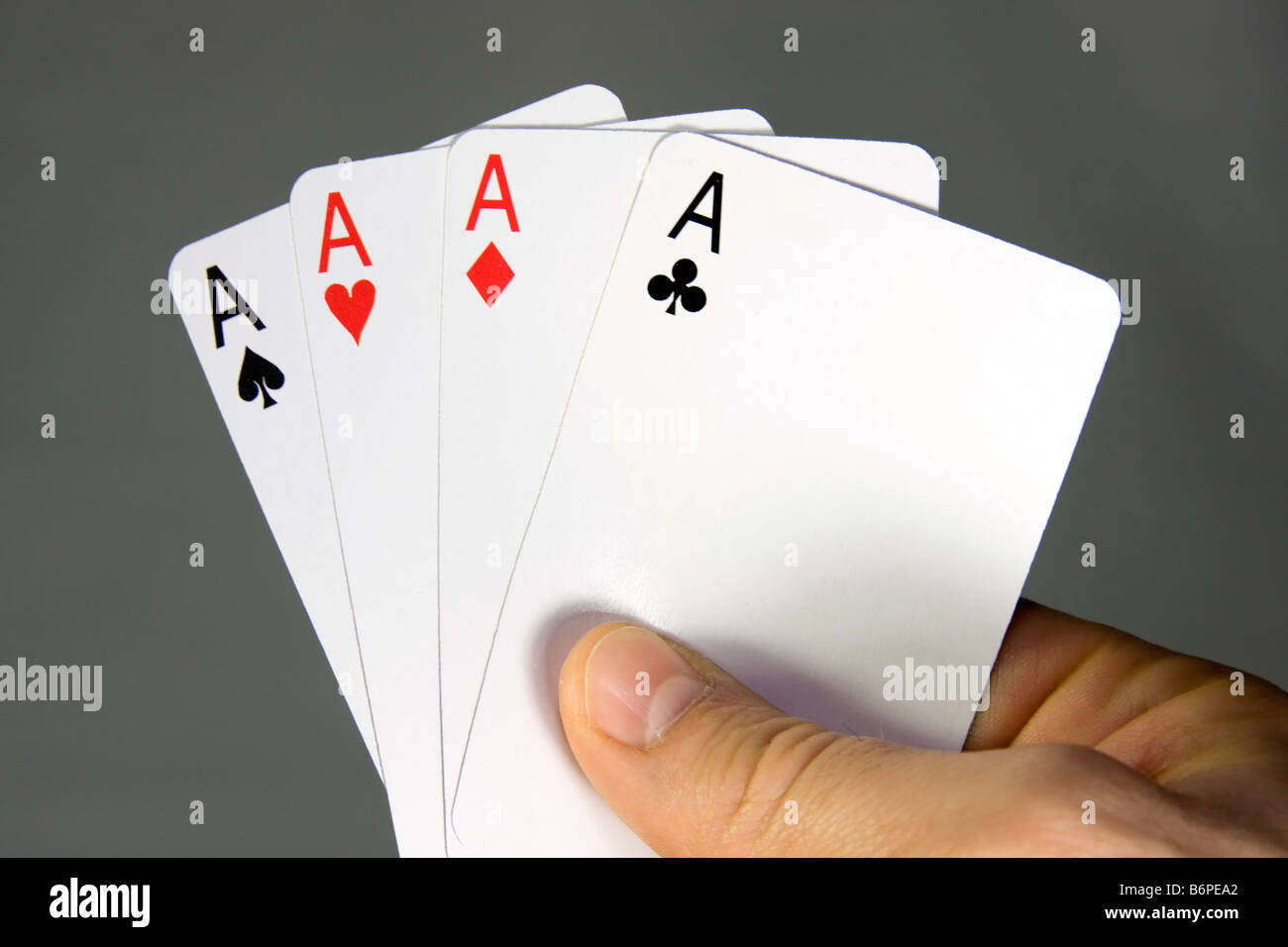 Hand with poker cards. Four of a kind. - Stock Image