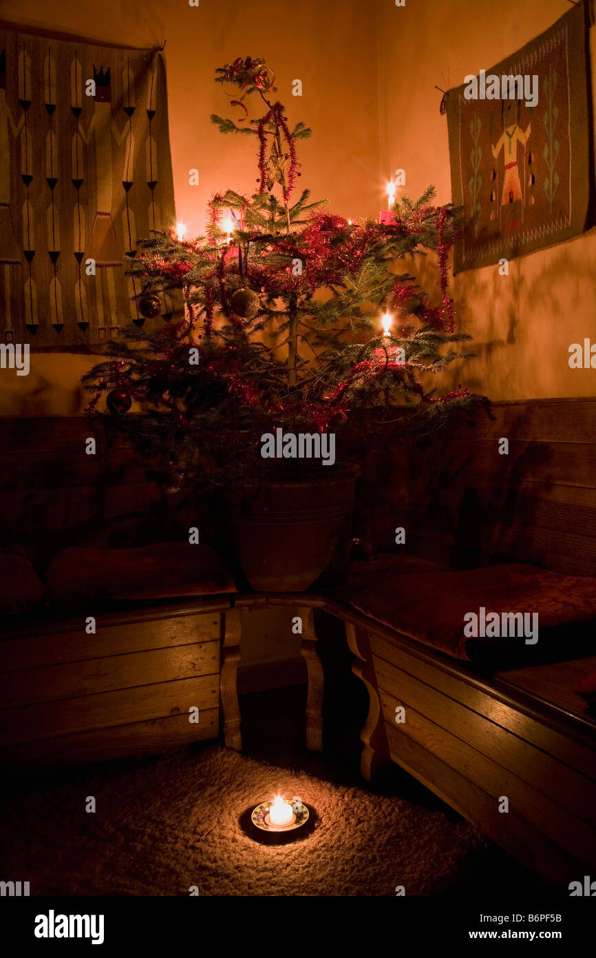Christmas at home with as many candles visible on the tree as there are children in our family. - Stock Image
