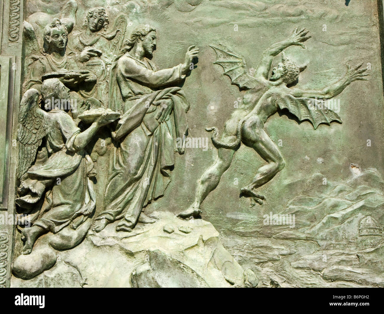 Pisa, Italy. Detail of the bronze doors of the Duomo, showing Satan being cast out of heaven by St Michael (by Giambologna - Stock Image