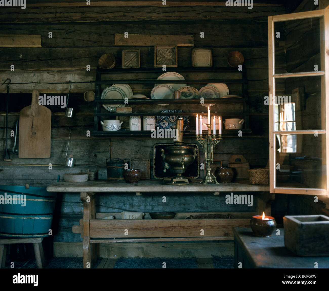 Candelabra with lighted candles on table in front of old wooden plate rack in rustic French & Plate Racks In Kitchen Stock Photos \u0026 Plate Racks In Kitchen Stock ...