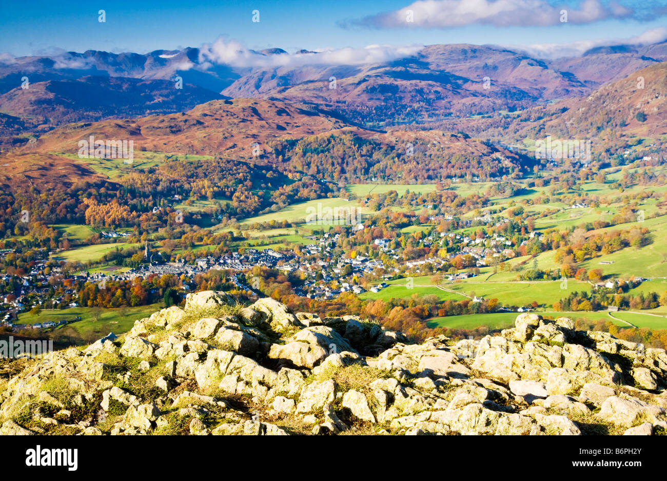 View over Ambleside from the path leading up to Wansfell Pike on a sunny autumn morning in the Lake District Cumbria - Stock Image