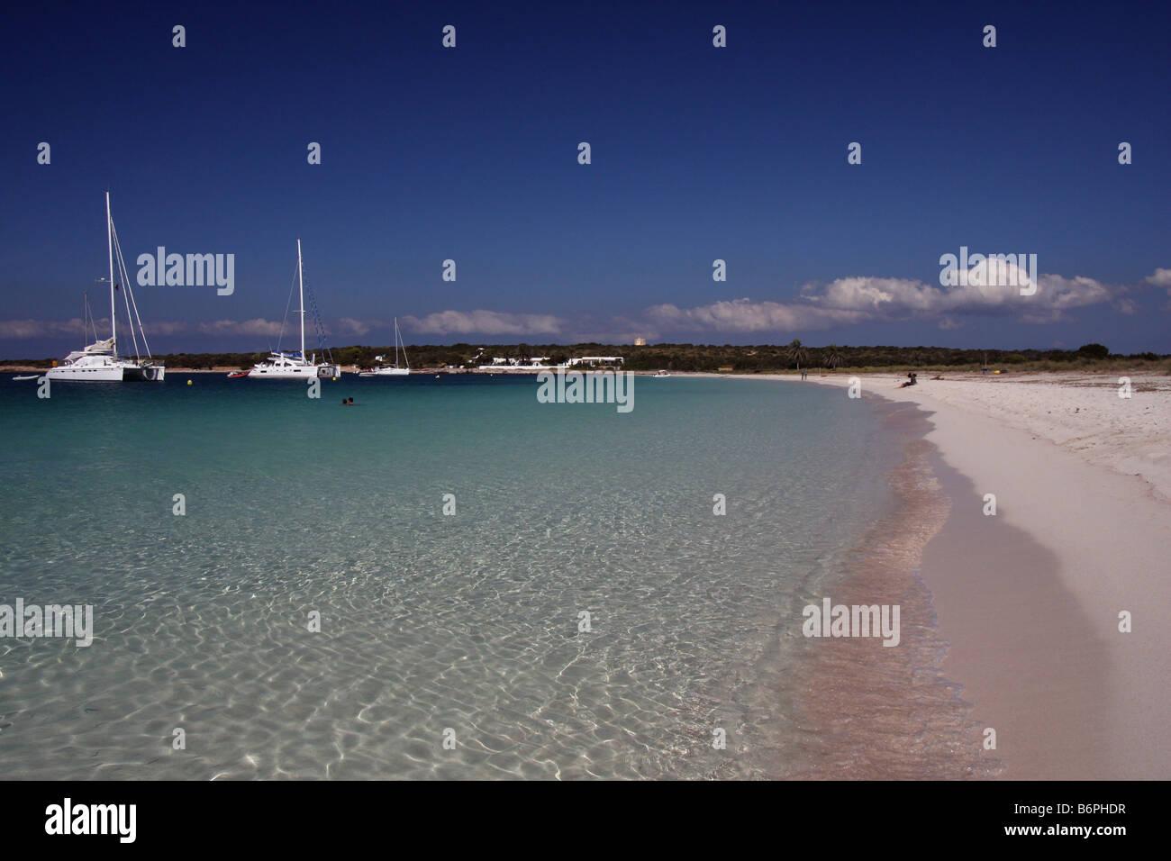 Sailing ships anchored in Isla de S'Espalmador, a small island next to Formentera and Ibiza, seen from the beach - Stock Image