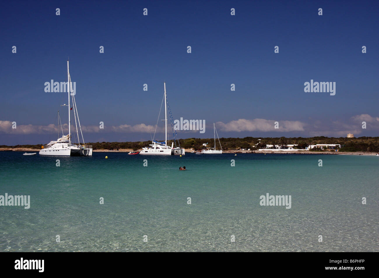 Sailing ships and yachts anchored in Isla de S'Espalmador, a small island next to Formentera and Ibiza, in the - Stock Image