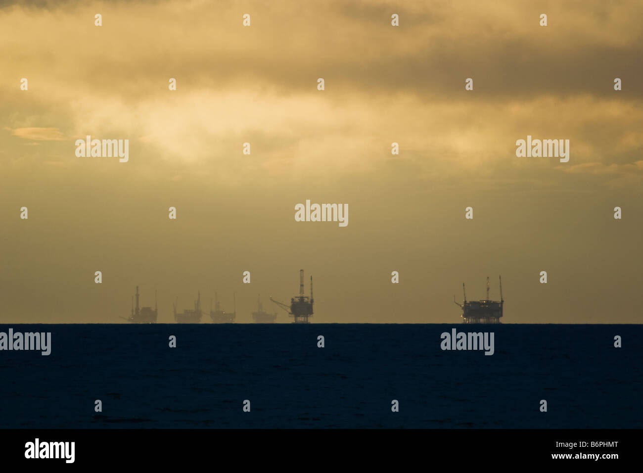 Oil platforms clustered off the Santa Barbara coast. - Stock Image