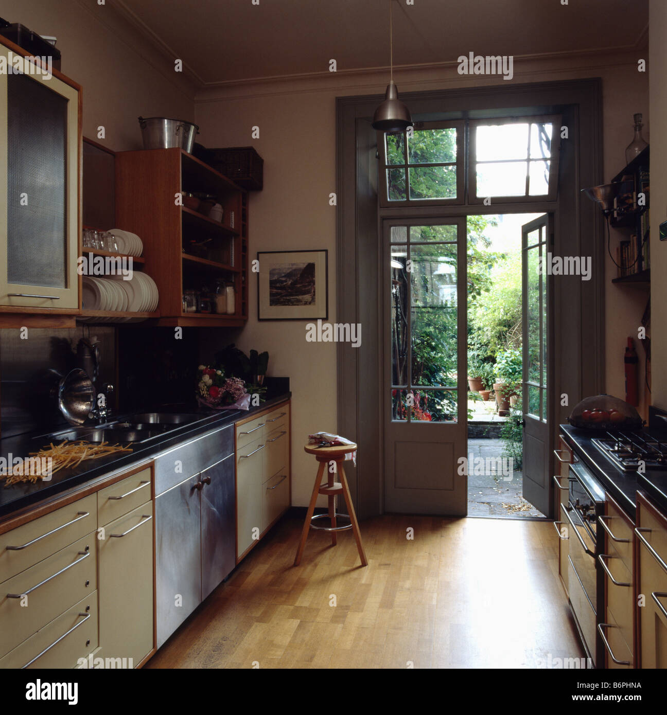 Kitchen With French Doors: Wooden Flooring In Modern Galley Kitchen With French Doors