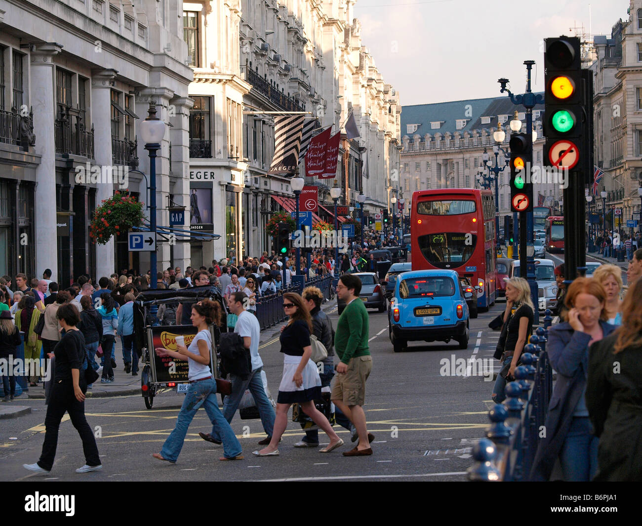 crowded Regent Street with many people shopping London UK - Stock Image