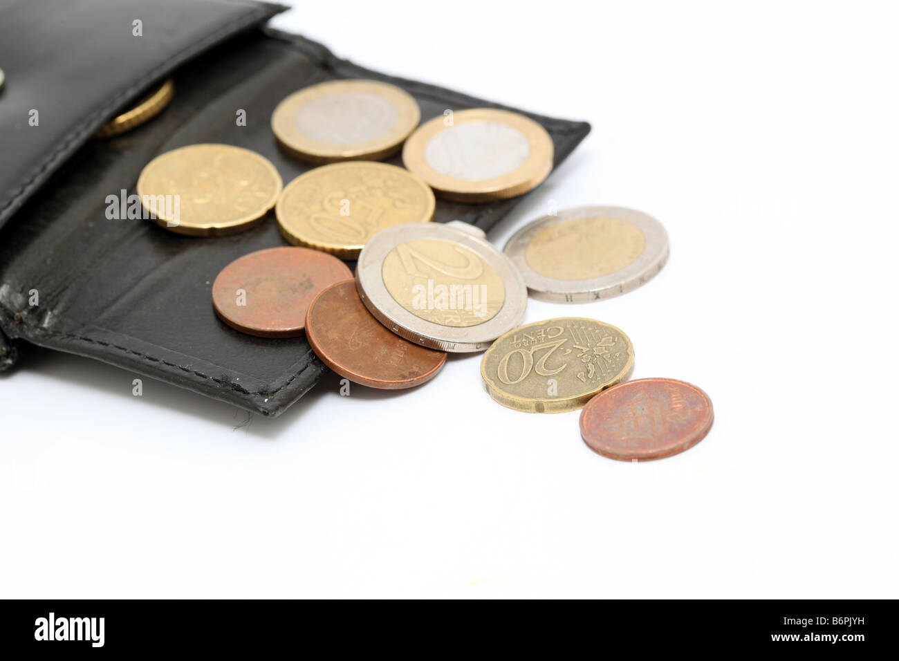 detail of euro coins out of black leather wallet isolated Stock Photo