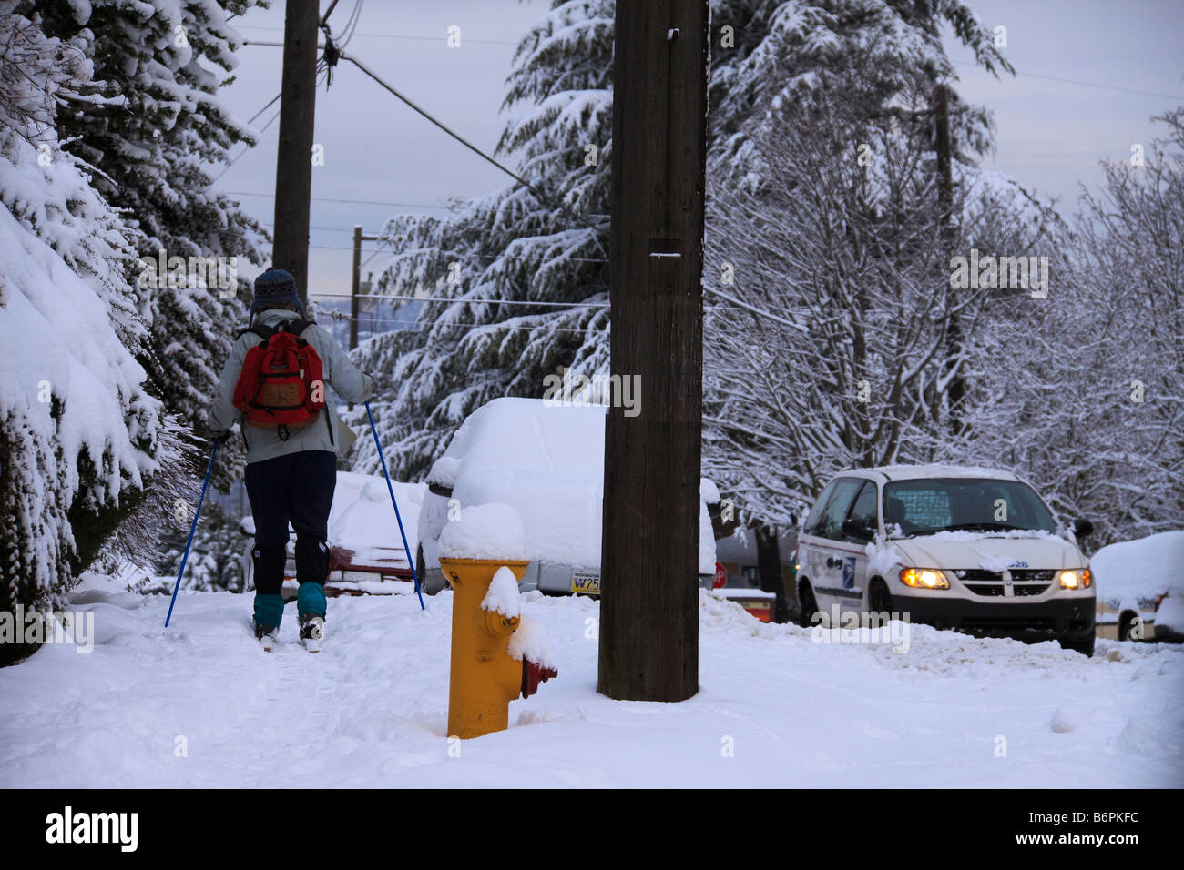 Woman using cross country skis in snow on Queen Anne Hill Seattle Washington Stock Photo