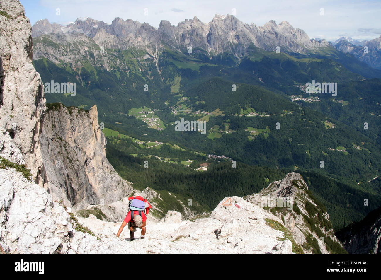 Climber in the Italian Dolomites approaching Forcella Comedon - Stock Image