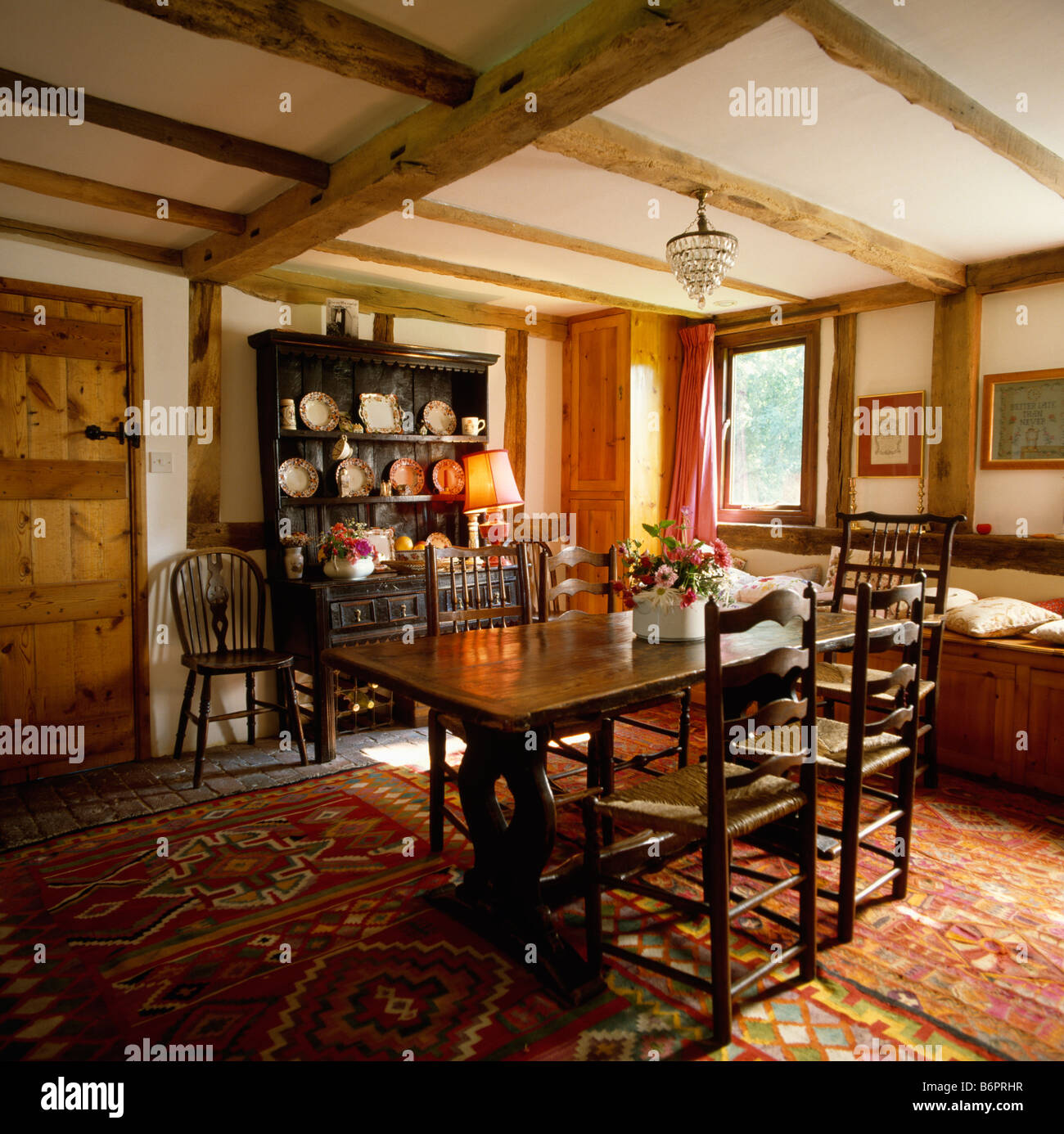 Small Country Table And Chairs: Antique Ladderback Chairs And Wooden Table In Small Country Dining Stock Photo: 21399779