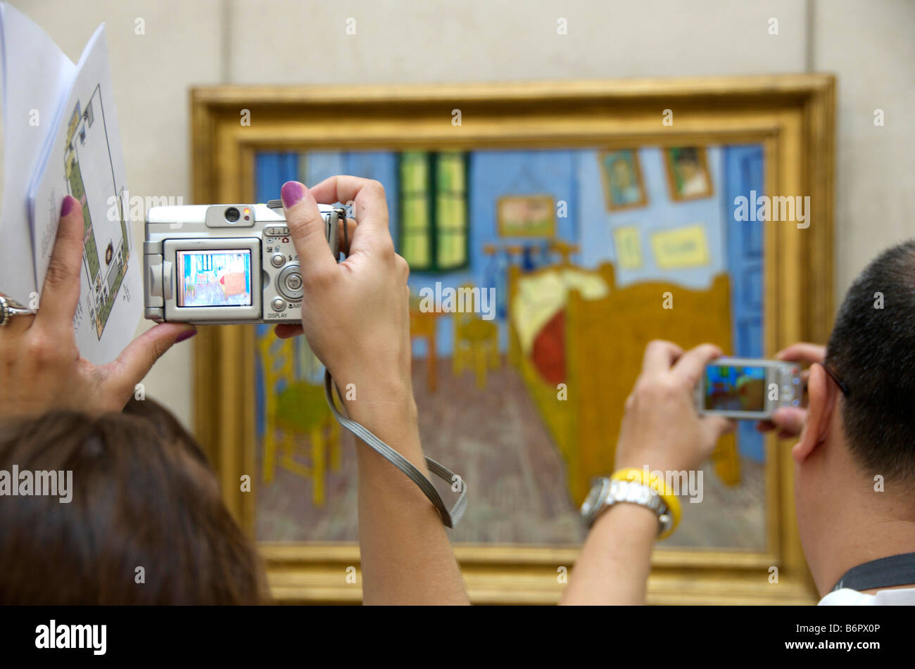 Tourists photographing a Vincent Van Gogh painting in the Musée d'Orsay, Paris - Stock Image