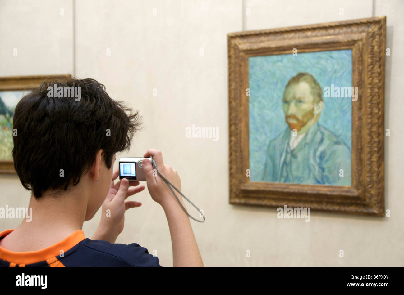 Van Gogh : Tourist photographing Vincent Van Gogh self-portrait painting in the Musee d'Orsay, Paris - Stock Image