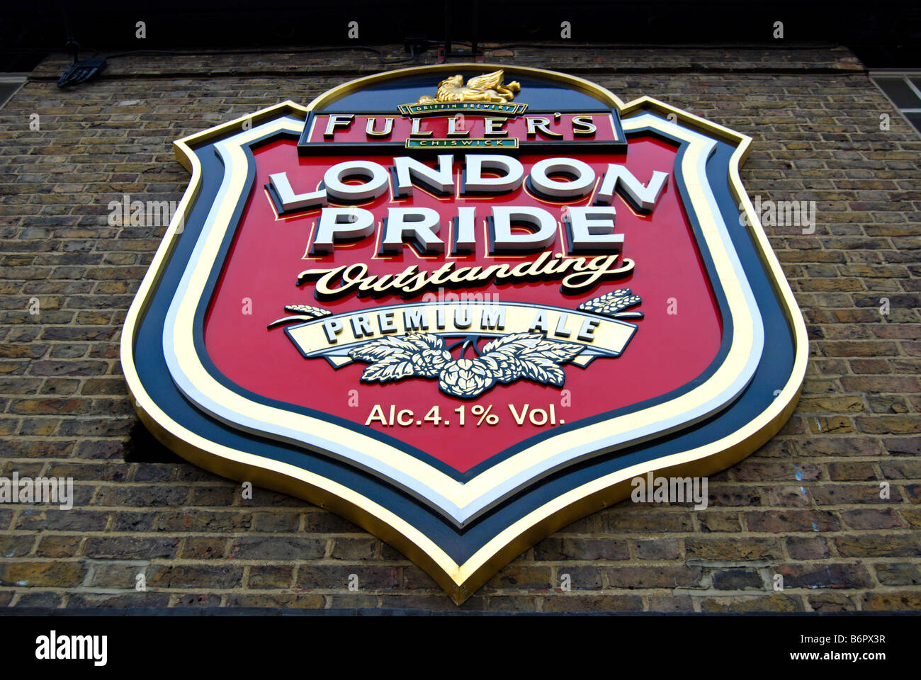 london pride logo on the wall of fuller's griffin brewery, chiswick, west london, england - Stock Image