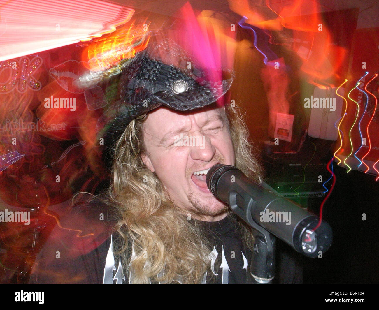 Kevin Lawless of the locally famous Bar band 'Liplock' sings during a show in West Haven Connecticut USA - Stock Image